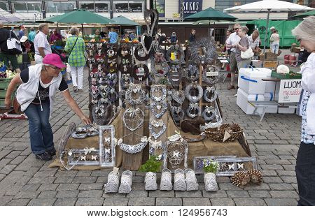 TURKU, ABO FINLAND ON JUNE 29 2013. View of an outdoor stand at a Market in the City on June 29, 2013 in Turku, Abo Finland. Trimmings for sale. Unidentified people. Editorial use.