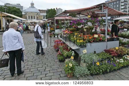 TURKU, ABO FINLAND ON JUNE 29 2013. View of outdoor stands at a Market in the City on June 29, 2013 in Turku, Abo Finland. Flowers and flowerpots. Unidentified people.