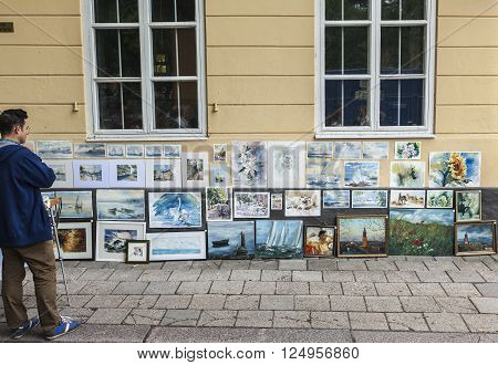 TURKU, ABO FINLAND ON JUNE 29 2013. View of an art exhibition at the Medieval Market in the City on June 29, 2013 in Turku, Abo Finland. Unidentified viewer this side.