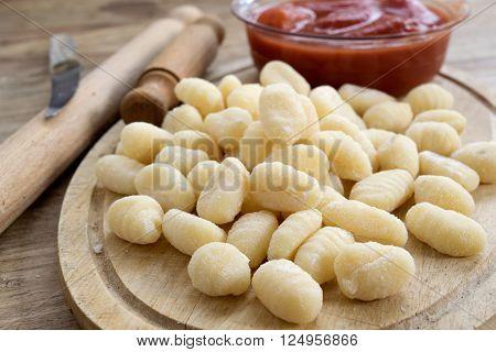 handmade potato dumplings or gnocchi with peeled tomatoes sauce