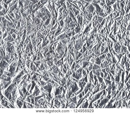 Silver leaf foil texture. Horizontal background with shiny crumpled uneven surface. For texture, backdrop, wallpaper