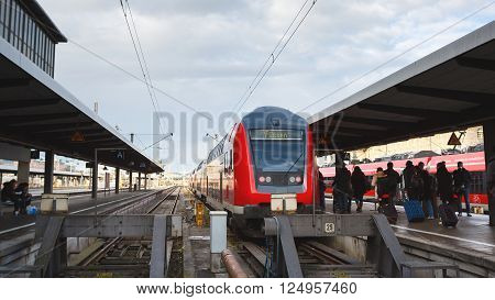 Munich Germany - January 06 2016: Tourists go to the train traveling to Fussen on the platform of the Railroad Station in Munich