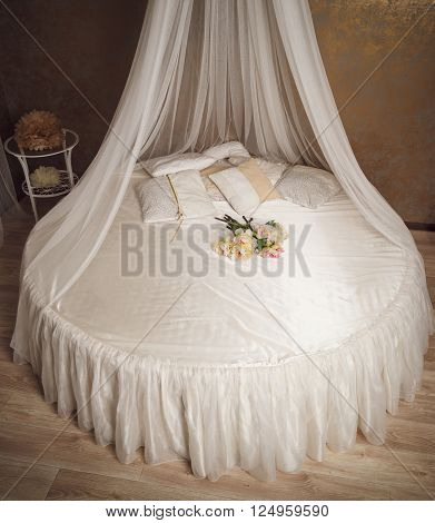 Home Interior With White Circle Bed With Canopy