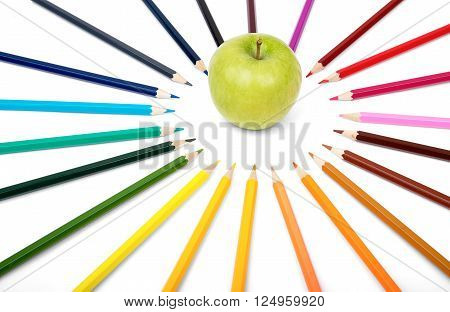 Apple with colorful crayons isolated on white background