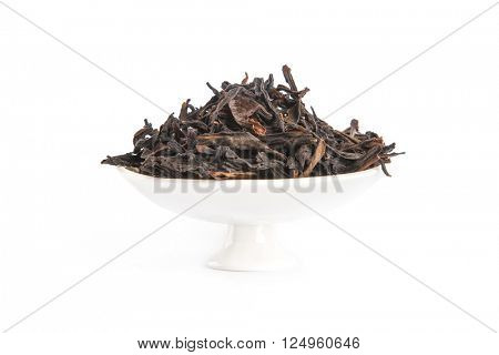 Honey Orchid Oolong on porcelain container, isolated on white background