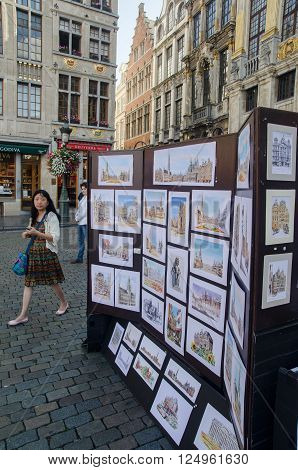 BRUSSELS - SEPTEMBER 3 2014 :Paintings on sale in the Grand Place Brussels Belgium