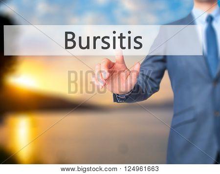 Bursitis - Businessman Hand Pressing Button On Touch Screen Interface.