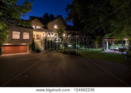 White Mansion With Cobbled Driveway