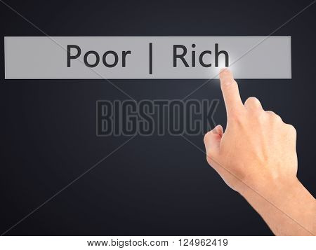 Poor  Rich - Hand Pressing A Button On Blurred Background Concept On Visual Screen.