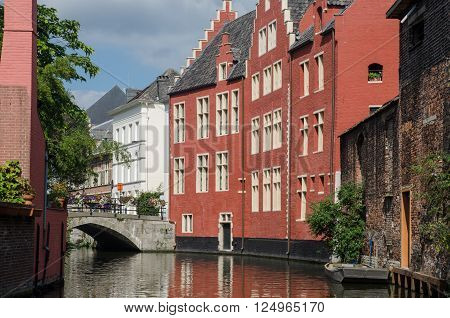 GENT BELGIUM - SEPTEMBER 9 2014: Medieval houses along water canal the old town of Ghent Belgium
