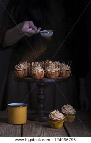 Pumpkin muffins with cream on a dark background fray cinnamon