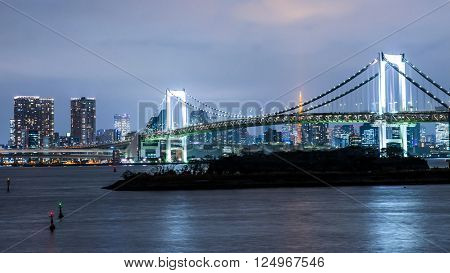 Tokyo skyline with Tokyo tower and rainbow bridge. Tokyo Japan.