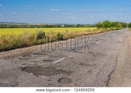 Bad road in Ukrainian rural area at summer
