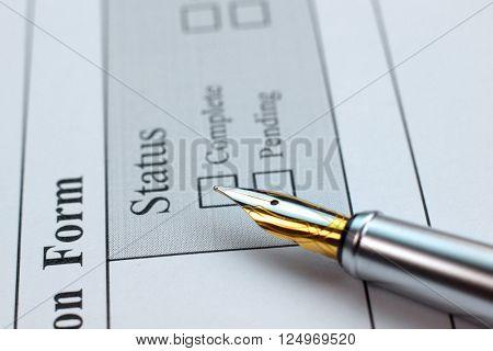 Application form status and pen closeup