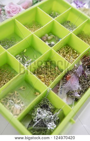 Accessories for needlework in container and tools for creating fashion jewelry in the manufacturing process. Jewelry Making. Workshop. Hobby - Bijouterie Modeling. Tools for Handmade