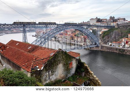 PORTO, PORTUGAL - November 26, 2014: metro train on the Dom Luis bridge and Porto city in the background
