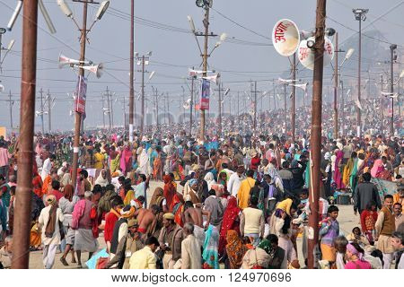 ALLAHABAD, INDIA - FEBRUARY 11, 2013: Thousands of Hindu devotees come to confluence of the Ganges and Yamuna River for holy dip during the festival Kumbh Mela. The world's largest religious gathering
