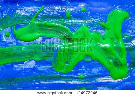 child painting of a green dragon on blue background