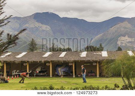 IMBABURA, ECUADOR, OCTOBER - 2015 - Two adult men playing volleyball at touristic place located in San Pablo lake Imbabura district Ecuador.