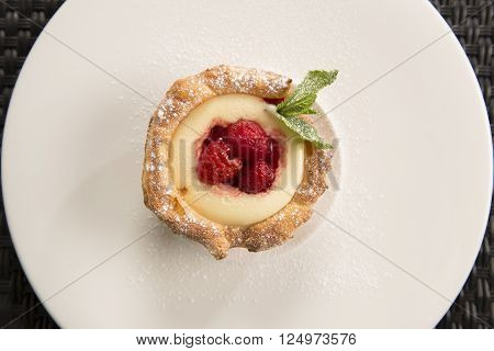 Lemon curd tartlet with raspberry compote with mint