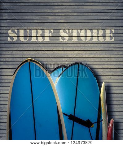Retro Filtered Surf Store Sign With Blue Surfboards