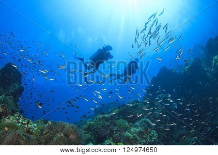 Scuba diving on oceanic coral reef underwater