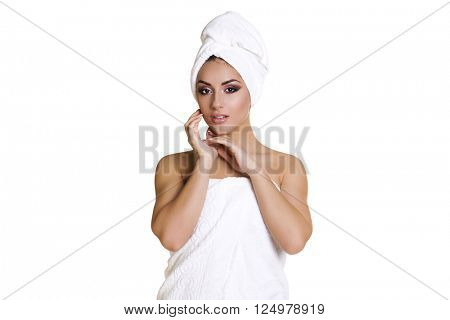Spa. Beautiful young arabic woman in white towel, isolated over white background