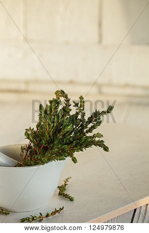 Mortar with Fresh Green Thyme on White background.