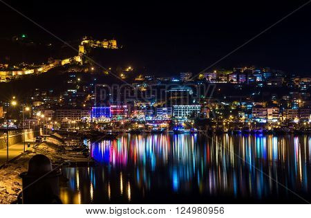 Night view of harbour, fortress and night lights in Alanya, Turkey