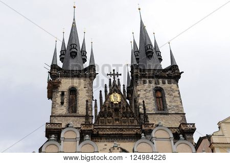 PRAGUE CZECH REPUBLIC - JULY 8 2009: Church of Mother of God before Tyn with the two gothic spires and the golden relief of Virgin Mary