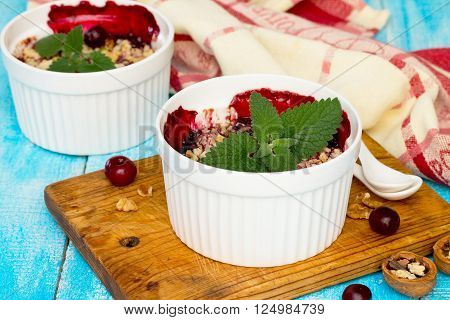 Homemade Cherry Crumble On A Blue Wooden Background