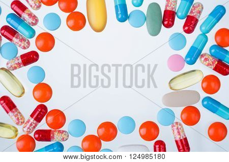 Many coloured pills of different size blank circle in the middle. Concept of medicine. Mock up.