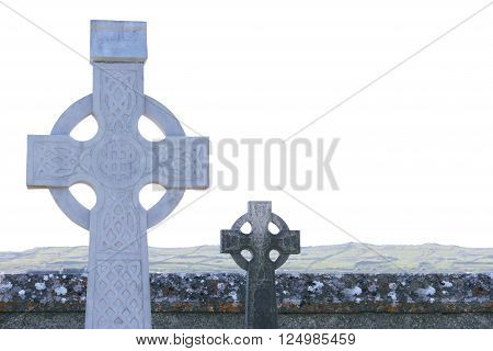 View on white and black old Celtic tombstones against of landscape