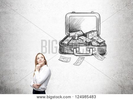 Businesswoman with hand at chin looking up open case with money drawn on concrete wall behind. Concept of making money.