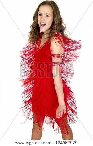Teenage ballroom dancer twisting in pretty red dress smiling