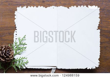 Blank vintage post card on a wooden background