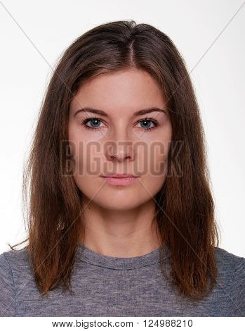Female head shot with neutral face expression and white background