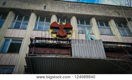 radiation sign in old ruined abandoned city Pripyat after nuclear disaster