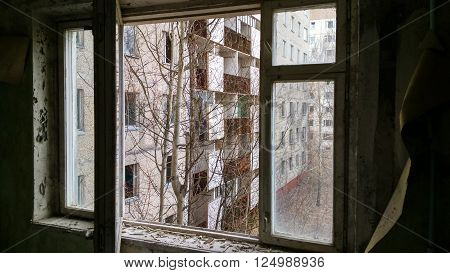 open window in abandoned city Pripyat in Ukraine