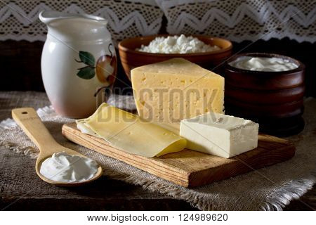 Dairy Products (milk, Cheese, Butter, Cottage Cheese, Sour Cream) On Table