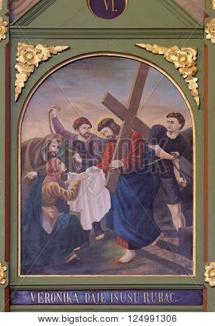 STITAR, CROATIA - NOVEMBER 24: 6th Stations of the Cross, Veronica wipes the face of Jesus, church of Saint Matthew in Stitar, Croatia on November 24, 2015