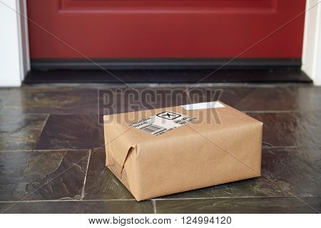 Close Up Of Parcel Delivery Outside Front Door