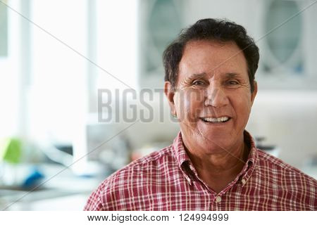 Head And Shoulders Portrait Of Senior Hispanic Man At Home