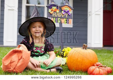 Portrait Of Girl Dressed In Trick Or Treating Witch Costume