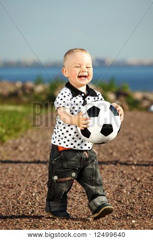 young smile boy play football