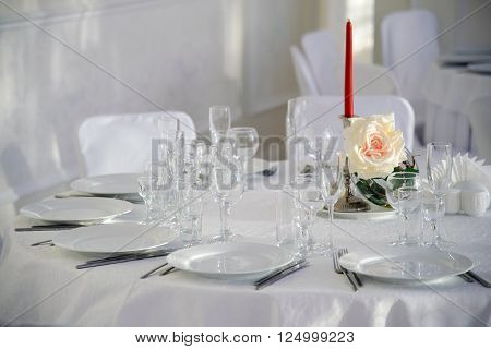 A festive table for a celebration. Banquet table with Cutlery and tableware. Table with white tablecloth served to guests. The table in the restaurant. Luxury Desk for the celebration.