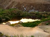 foto of urbanisation  - a dangerous toxic pond near a city waste landfill - JPG