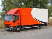 pic of delivery-truck  - this is a picture of an orange and white european delivery truck ready to deliver its goods - JPG
