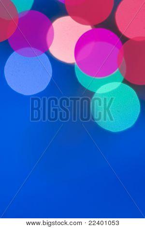blur lights , defocused card on blue  background