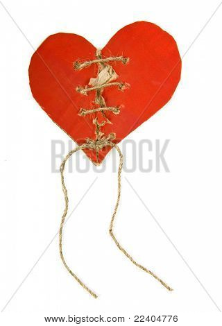 Torn cardboard heart with rope isolated on white background
